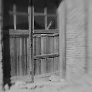 Wood Doors Decaying Brick Building - Bodie, CA - Lensbaby - Black & White