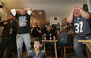 SUPERBOWL WATCHING 020406<br /> <br /> SECOND OF A PAIRING OF PHOTOS:<br /> <br /> At the home of Javier Morales (CQ) in West Seattle:  Mauricio Martinez (CQ), with hands up, Miguel Bocanegra (CQ), sitting in middle, Jeff Hernandez, right, and Elias Morales (CQ), below in front.