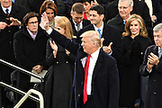 President Donald Trump waves to the crowd following his Inaugural address after being sworn-in as the 45th President on Capitol Hill January 20, 2017 in Washington, DC.