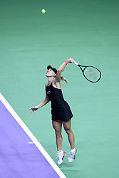 October 24, 2018 - Singapore - Angelique Kerber of Germany serves during the match between Angelique Kerber and Naomi Osaka on day 4 of the WTA Finals at the Singapore Indoor Stadium. (Credit Image: © Paul Miller/ZUMA Wire)