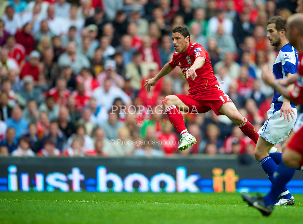 LIVERPOOL, ENGLAND - Saturday, April 23, 2011: Liverpool's Maximiliano Ruben Maxi Rodriguez completes his hat-trick, scoring his side's fourth goal against Birmingham City during the Premiership match at Anfield. (Photo by David Rawcliffe/Propaganda)