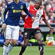 NLD/Rotterdam/20100919 - Voetbalwedstrijd Feyenoord - Ajax 2010, Siem de Jong in duel met