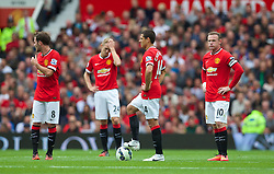 16-08-2014 ENG: Premier League, Manchester United vs Swansea City, Manchester<br /> Manchester United's Wayne Rooney looks dejected as Swansea City score the opening goal<br /> <br /> ***NETHERLANDS ONLY***