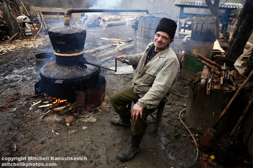"Rural Romanian man making the traditional alcoholic drink called ""?uic?"" (pronounced Tsuika). Maramures, Romania"