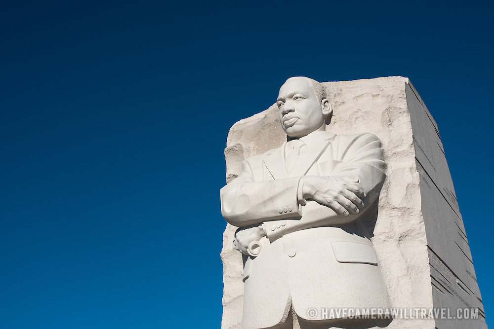 The central statue at the National Martin Luther King Jr Memorial next to the Tidal Basin in Washington DC, against a clear blue sky.