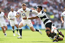 Elliot Daly of England fends Victor Vito of the Barbarians - Mandatory byline: Patrick Khachfe/JMP - 07966 386802 - 27/05/2018 - RUGBY UNION - Twickenham Stadium - London, England - England v Barbarians - Quilter Cup