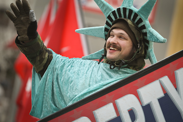 Joe Aiken, professional waver, on tax day at Liberty Tax Service on the corner of Benson and C Street, Anchorage