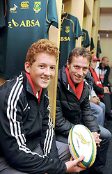 Cape Town-130927-16 Year old Bryce Jones-Phillipson (LEFT) from Bergvliet won a tour of SA Breweries and Springbok change-room (where this pic was taken) and Captain's Run at Newlands Stadium with rugby legend, Corne Krige (RIGHT)-Reporter-Soyiso-Photographer-Tracey Adams