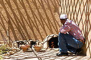 Family prepares madfouna - the Berber pizza - in a mud oven at an earthen home in Hassilabied village, Southern Morocco, 2016-04-13. <br />