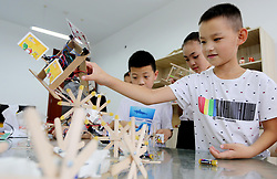 August 20, 2017 - Lianyungan, Lianyungan, China - Lianyungang, CHINA-20th August 2017: (EDITORIAL USE ONLY. CHINA OUT) ..Pupils learn knowledge on robot during summer vacation in Lianyungang, east China's Jiangsu Province. (Credit Image: © SIPA Asia via ZUMA Wire)