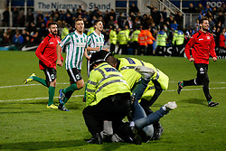 Police detain pitch invaders as Alex Nicholson of Blyth Spartans and other players run accross to their fans after they win 1-2 to progress to the next round of the FA Cup - Photo mandatory by-line: Rogan Thomson/JMP - 07966 386802 - 05/12/2014 - SPORT - FOOTBALL - Hartlepool, England - Victoria Park - Hartlepool United v Blyth Spartans - FA Cup Second Round Proper.