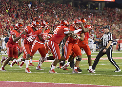 September 16, 2017 - Houston, TX, USA - Teammates congratulate Houston Cougars defensive lineman Payton Turner (98) on a tipped ball interception during the first quarter of the college football game between the Houston Cougars and the Rice Owls at TDECU Stadium in Houston, Texas. (Credit Image: © Scott W. Coleman via ZUMA Wire)