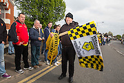 scarf and flag seller during the Sky Bet Championship match between Watford and Sheffield Wednesday at Vicarage Road, Watford, England on 2 May 2015. Photo by Phil Duncan.