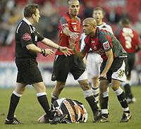 Photo: Aidan Ellis.<br /> Darlington v Swansea City. The FA Cup. 02/12/2006.<br /> Swansea's Sylvain meslein pleads his innocence after fouling Darlington's Neil Wainwright