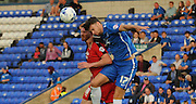 Alex Davey winning the header during the Capital One Cup match between Peterborough United and Crawley Town at London Road, Peterborough, England on 11 August 2015. Photo by Michael Hulf.