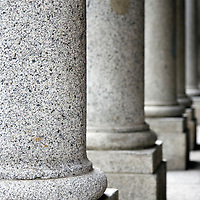 Graphic abstract image of lined up granite columns