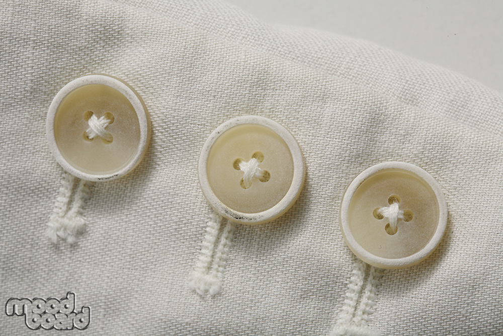 Close-up of buttons on cloth