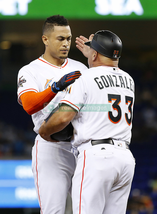 June 21, 2017 - Miami, FL, USA - Miami Marlins right fielder Giancarlo Stanton is congratulated by third base coach Fredi Gonzalez after hitting an RBI single during the eighth inning against the Washington Nationals on Wednesday, June 21, 2017 at Marlins Park in Miami, Fla. (Credit Image: © David Santiago/TNS via ZUMA Wire)