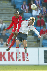OSLO, NORWAY - Thursday, May 27, 2004:  Wales' Daniel Gabbidon and Norway's Thorstein Helstad during the International Friendly match at the Ullevaal Stadium, Oslo, Norway. (Photo by David Rawcliffe/Propaganda)