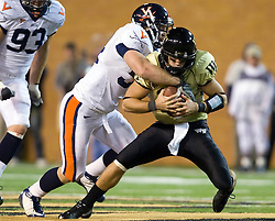 Virginia linebacker Jon Copper (54) sacks Wake Forest quarterback Riley Skinner (11).  The Wake Forest Demon Deacons defeated the Virginia Cavaliers 24-17 in NCAA Division 1 Football at BB&T Field on the campus of Wake Forest University in Winston-Salem, North Carolina on November 8, 2008.