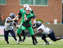 Oct 3, 2015; Huntington, WV, USA; Marshall Thundering Herd quarterback Chase Litton runs out of the pocket during the second quarter against the Old Dominion Monarchs at Joan C. Edwards Stadium. Mandatory Credit: Ben Queen-USA TODAY Sports