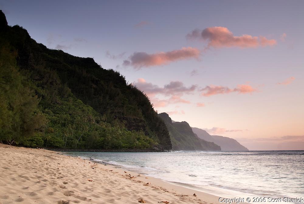 Ke'e Beach on the north shore of Kauai leads to the lush green cliffs of the Na Pali coast.