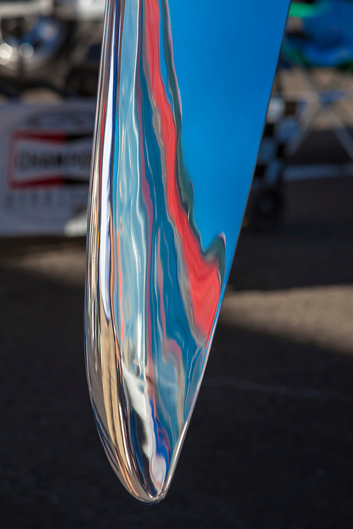 "Prop blade reflection from ""Precious Metal"", a highly modified P-51 Mustang with counter-rotating propellers, in the pits at the 2012 Reno Air Races."