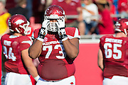 LITTLE ROCK, AR - OCTOBER 18:  Sebastian Tretola #73 of the Arkansas Razorbacks reacts to his team losing a fumble during a game against the Georgia Bulldogs at War Memorial Stadium on October 18, 2014 in Little Rock, Arkansas.  The Bulldogs defeated the Razorbacks 45-32.  (Photo by Wesley Hitt/Getty Images) *** Local Caption *** Sebastian Tretola
