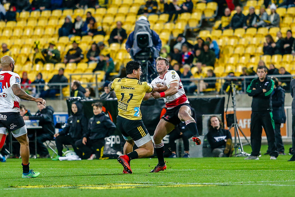 Ben Lam fends during the Super rugby (Round 12) match played between Hurricanes  v Lions, at Westpac Stadium, Wellington, New Zealand, on 5 May 2018.  Hurricanes won 28-19.