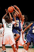 December 18, 2010: Jazzmin Lewis of the California Riverside Highlanders tries to shoot past Krystal Saunders (12) and Maria Brown (50) of the Miami Hurricanes during the NCAA basketball game between the Hurricanes and the Highlanders. The 'Canes defeated the Highlanders 81-59.