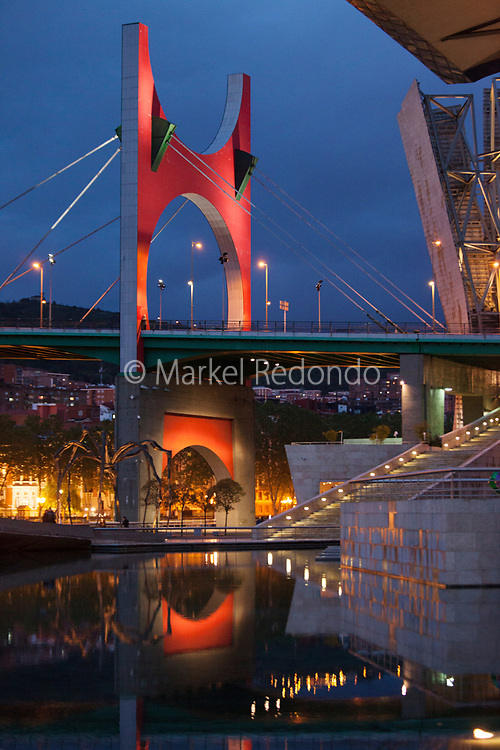 A view of the Guggenheim museum and la Salve bridge by night in Bilbao, Spain.