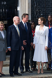 Image ©Licensed to i-Images Picture Agency. 10/06/2014. London, United Kingdom. In the frame - Angelina Jolie with David Cameron ( C ) and William Hague (L).<br /> Angelina Jolie meets with Prime Minister David Cameron and Foreign Secretary William Hague as part of the Global Summit to End Sexual Violence in Conflict global summit, at at 10 Downing Street. Picture by Nils Jorgensen / i-Images