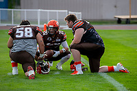 KELOWNA, BC - AUGUST 17:  Danil BALAN #58 and Daniel TOWNSEND #66 kneel on the field with Tyler GOING #20 of Okanagan Sun during pre-game warm up against the Westshore Rebels  at the Apple Bowl on August 17, 2019 in Kelowna, Canada. (Photo by Marissa Baecker/Shoot the Breeze)