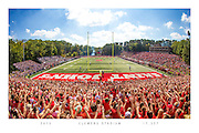 COMMEMORATIVE PRINT: A general view of Clemens Stadium featuring a Division III record crowd of 17,327 during a game between the Saint John's Johnnies and St. Thomas Tommies on September 26, 2015 in Collegeville, Minnesota.