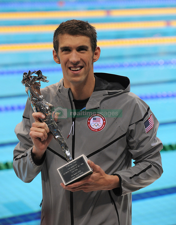 """USA's Michael Phelps with his award for """"The Greatest Olympic Athlete Of All Time"""" after winning his 22nd Olympic Medal, which included 18 Gold Medals"""