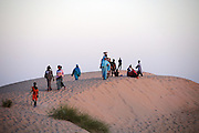 Tuareg people gather for the beginning of the 2010 edition of the Festival au Désert in Timbuktu, Mali