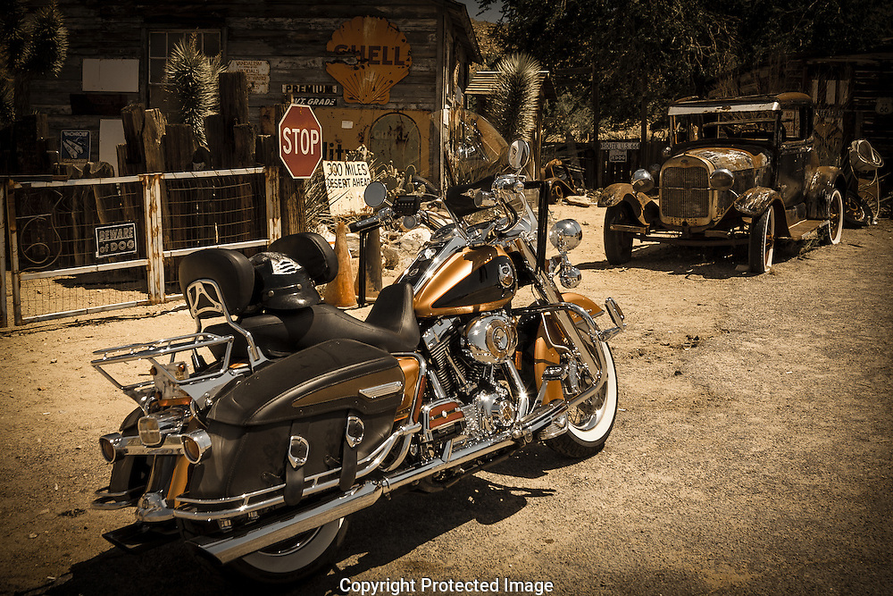 New Harley Davidson motorcycle parked among the past on Route 66 in Hackberry, Arizona