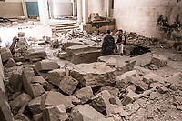 Rubbles of statues are seen in destroyed Mosul Museum.