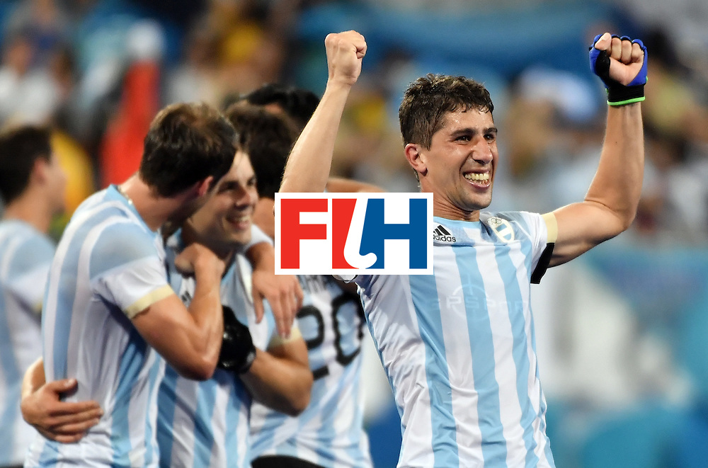 Argentina's Ignacio Ortiz (R) celebrates with teammates after winning the men's Gold medal field hockey Belgium vs Argentina match of the Rio 2016 Olympics Games at the Olympic Hockey Centre in Rio de Janeiro on August 18, 2016. / AFP / Pascal GUYOT        (Photo credit should read PASCAL GUYOT/AFP/Getty Images)