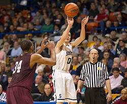 Parkersburg South guard Ty Dobson (0) shoots a three pointer over Woodrow Wilson forward Noah Hancock (34) during a semi-final game at the Charleston Civic Center.
