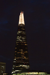 "© Licensed to London News Pictures. 05/07/2014. London, UK. The Shard in London is seen with lights switched on ahead of ""lights off"". Landmarks across London and the UK are turning their lights off from 10pm to 11pm tonight to mark the First World War centenary. Photo credit : Vickie Flores/LNP"