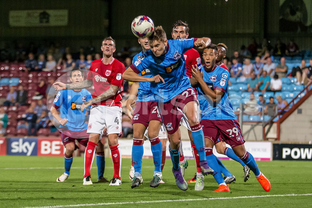 Conor Townsend of Scunthorpe United heads the ball clear during the EFL Cup second round match between Scunthorpe United and Bristol City at Glanford Park, Scunthorpe, England on 23 August 2016. Photo by James Williamson.