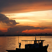 A boatman ends a day of fishing on West Lake, Hanoi, Vietnam.