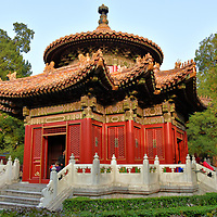 Autumn Pavilion at Forbidden City in Beijing, China<br /> On the east side of the garden is the Autumn Pavilion. Qianqiuting has the identical design of the Springtime Pavilion. Both structures have a multifaceted base representing the earth with a conical roof symbolizing heaven. Near the top is a glazed pot with a colorful bas-relief of mythical creatures flanked by two dragon sculptures. These pavilions were created during the early 15th century and then rebuilt in 1535.