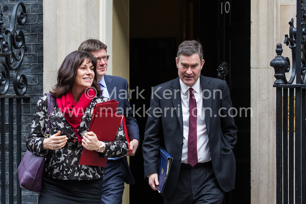London, UK. 12th February, 2019. Claire Perry MP, Minister for Energy and Clean Growth at the Department of Business, Energy and Industrial Strategy, Greg Clark MP, Secretary of State for Business, Energy and Industrial Strategy, and David Gauke MP, Lord Chancellor and Secretary of State for Justice, leave 10 Downing Street following a Cabinet meeting.