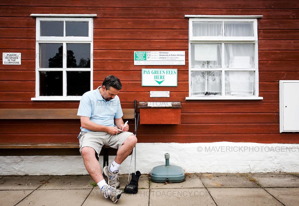 "Golfer Henry Murdoch, fills out an envelope with his fee for the ""honesty box"" for playing on the course at Strathtay Golf Club in Perthshire, Scotland...Strathtay Golf Club is like many small rural golf curses in Scotland which employ an ""honesty box"" system where golfers deposit money in a  box rather than go to the expense of hiring a full time person to collect green fees...Picture Michael Hughes/Maverick."