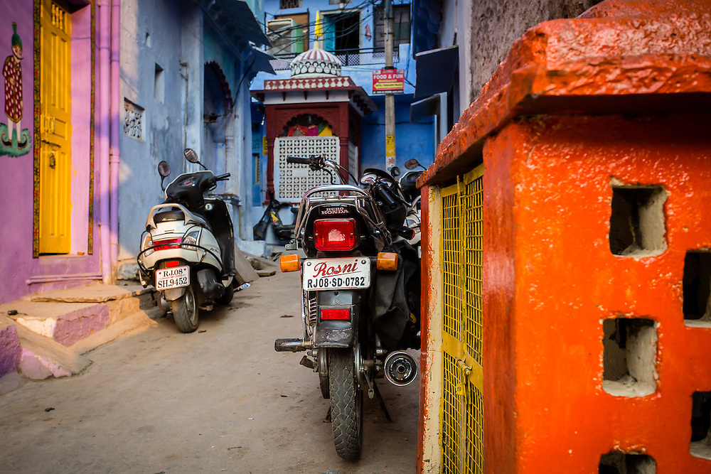Some bikes are parked in a colorful alley in Bundi. Motorbikes are probably the main means of transportation in the narrow streets of Bundi.
