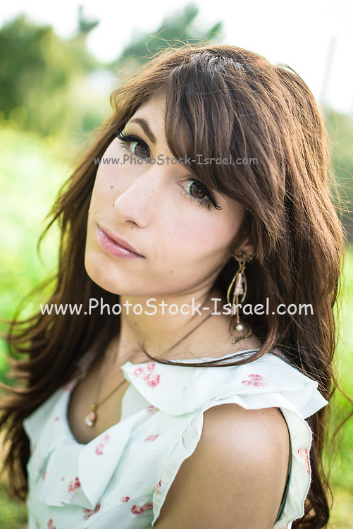 Portrait of a young middle eastern woman in a park