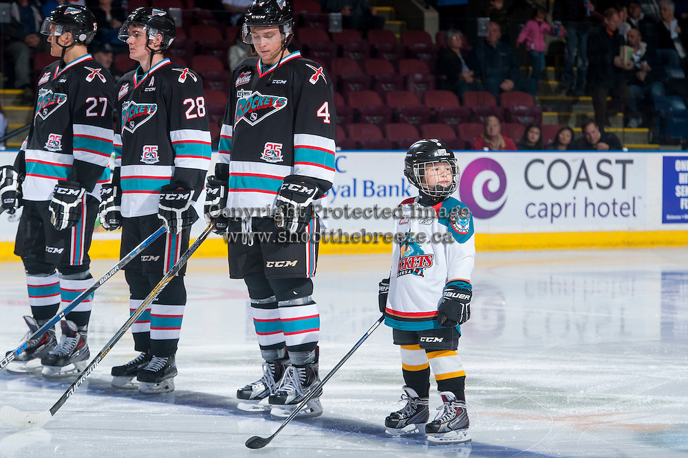 KELOWNA, CANADA - OCTOBER 24: Joe Gatenby #28 and Gordie Ballhorn #4 of Kelowna Rockets line up with the Pepsi Save On Foods Player of the game against the Calgary Hitmen on October 24, 2015 at Prospera Place in Kelowna, British Columbia, Canada.  (Photo by Marissa Baecker/Shoot the Breeze)  *** Local Caption *** Joe Gatenby; Gordie Ballhorn; Pepsi Save On Foods Player;