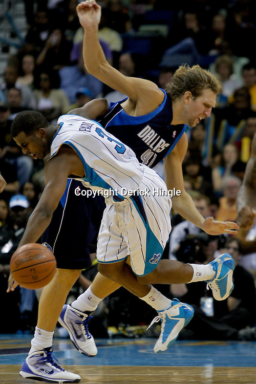 Nov 04, 2009; New Orleans, LA, USA; Dallas Mavericks forward Dirk Nowitzki (41) of Germany and New Orleans Hornets guard Chris Paul (3) collide during the third quarter at the New Orleans Arena. The Hornets defeated the Mavericks in overtime 114-107. Mandatory Credit: Derick E. Hingle-US PRESSWIRE.